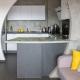 cuisine ouverte conception sur-mesure séparation plan de travail architecture décoration agencement céramique éléments hauts rangements